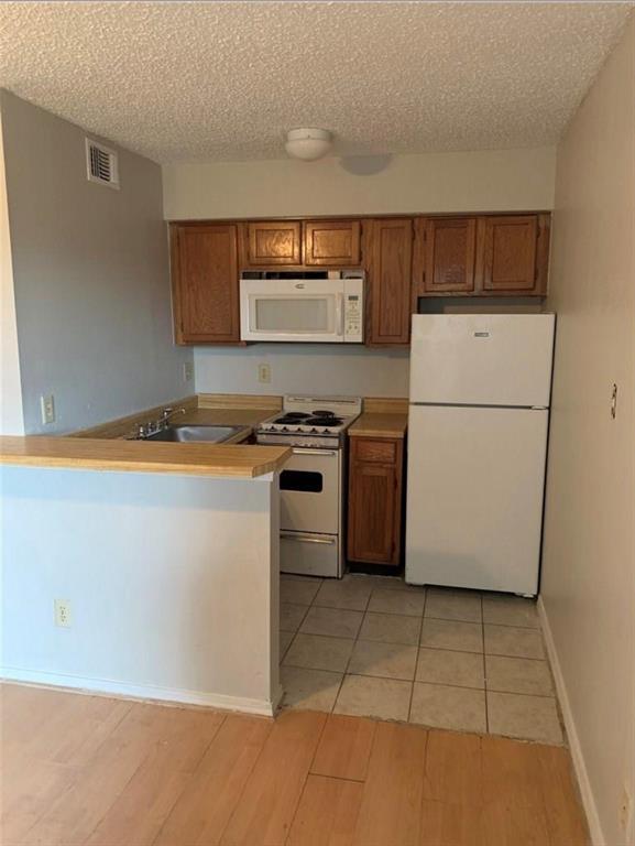 Sold Property | 9809 Walnut Street #308 Dallas, Texas 75243 1