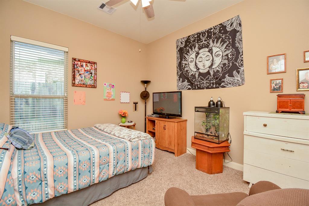 Off Market   222 Chirping Squirrel Court Pinehurst, Texas 77362 12