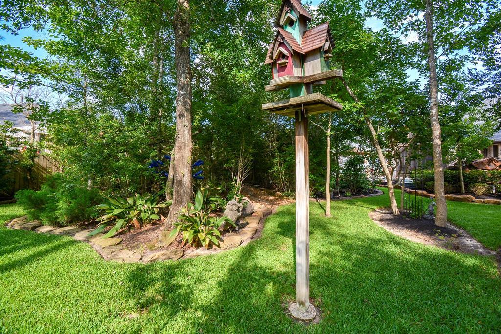 Off Market   222 Chirping Squirrel Court Pinehurst, Texas 77362 34